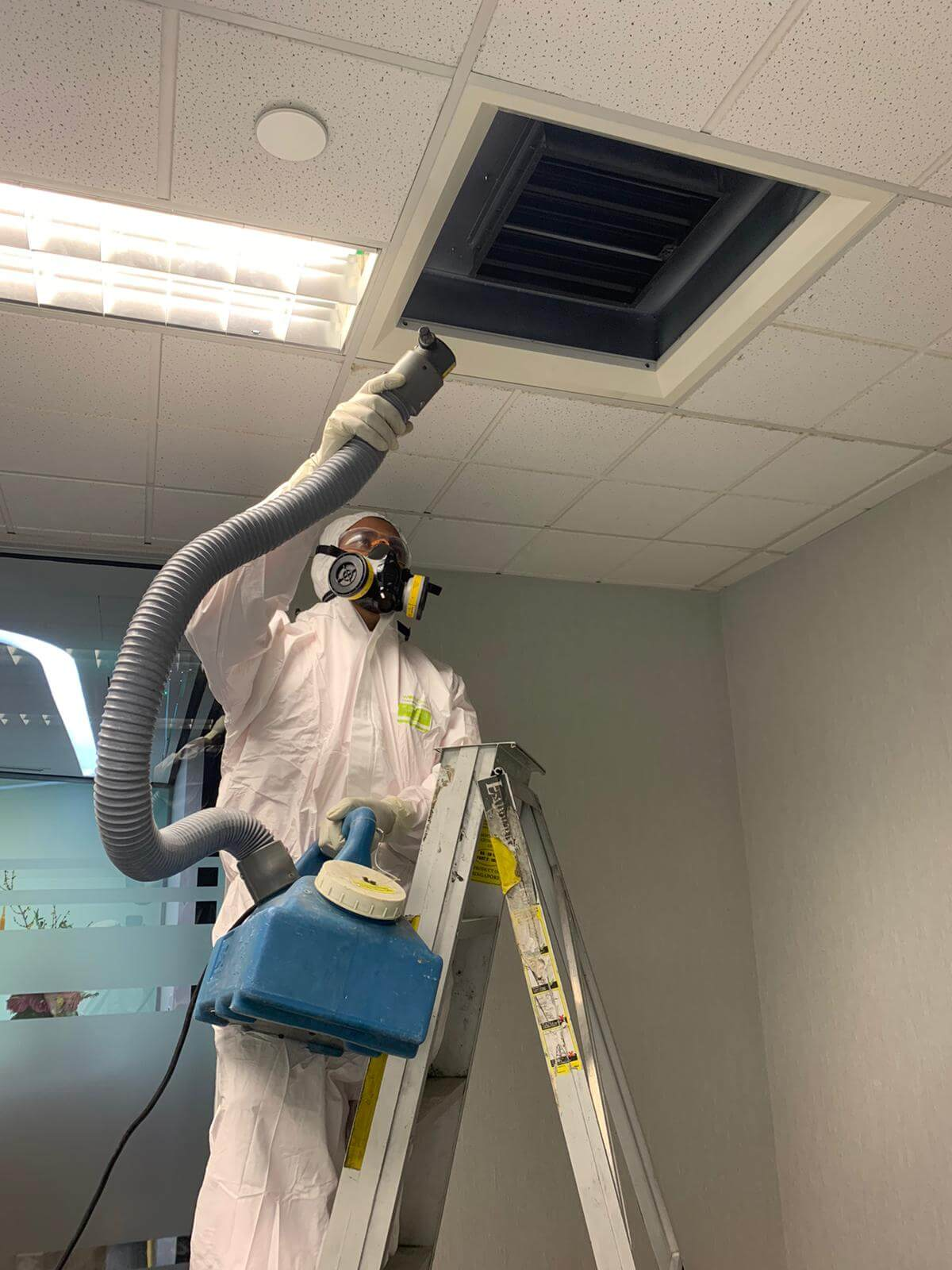 Technician Disinfecting a Facility